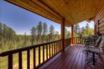 Arrow Lodge -  Deck view of log cabin.