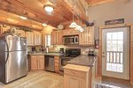 Arrow Lodge -Kitchen with stainless steel appliances.