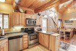 Arrow Lodge -Kitchen with wood cabinets and trim.
