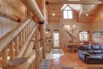 Arrow Lodge-Living room and log stair case.