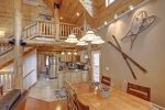 Arrow Lodge- Log stair case and spacious main floor.
