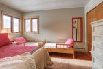 Lizzy`s Getaway bedroom with Queen bed and twin beds.