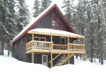Alpine Retreat - Front view of cabin in the winter.
