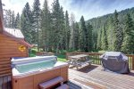 Black Bear Lodge deck with hot tub, grill and  picnic table.