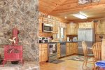Blac k Bear Lodge with rock wood stove and kitchen.