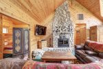 Black Bear Lodge with beautiful wood fire place and vaulted wood ceiling.