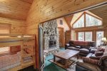 Black Bear Lodge living area with beautiful views and bunk beds .