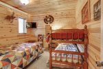 Cabin Fever down stairs living room with leather furniture.