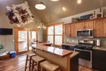 Iron Horse Cabin kitchen with breakfast bar.