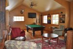 Clubhouse game room with pool table and foosball