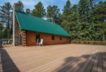 Beautiful log cabin with huge wrap around deck.