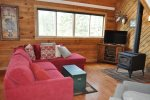 Living Room with flat screen TV, wood stove