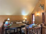 Cash Sluice Lodge bedroom with Queen Log bed.