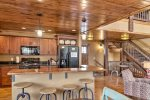 Gray  Goose Lodge kitchen with wood ceiling and floors.