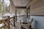 Gray Goose Lodge deck with forest views.