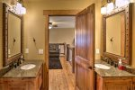 Gray Goose Lodge bath with double vanities.