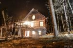 Outback Log Cabin at night