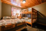 Lower Bedroom with queen bed and full-size bunks