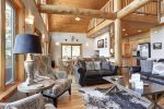 In  The Snow Lodge living room with log beams.
