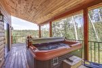 In The Snow Lodge  deck with large hot tub.