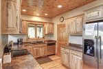 In The Snow Lodge kitchen with stainless Steel appliances.