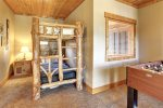 Alpine Escape - Kids Bedroom with bunk beds and foosball table.