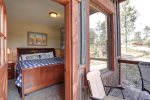 Alpine Escape -Bedroom with king bed and walk out deck.