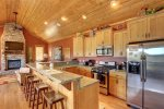 Alpine Escape - Kitchen with Breakfast Bar and stainless Steel appliances.