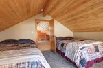 Couloir Cabin upstairs bedroom with two queen beds.