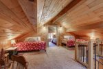 Couloir Cabin loft area with two queen beds.