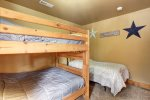 Big Bear Lodge  bedroom with bunks and a twin.