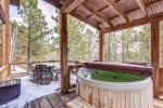 Big Bear Lodge back deck with hot tub and  patio table and chairs.