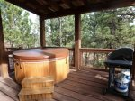 Big Bear Lodge back deck with hot tub and propane grill.