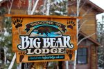 Big Bear Lodge front of cabin with sign.