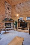Floor to ceiling rock fire place with natural gas.