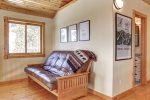 Grand View Lodge loft with leather sofa bed.