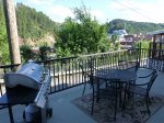 Historic Deadwood Home deck with gas grill and patio table.