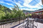 Historic Deadwood Home deck with grill and view of the city.