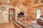 Eagle`s Lair main floor with wood wall coverings and log beams.