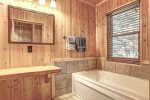 Eagle`s Lair bath with whirlpool tub.