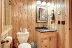 Eagle`s Lair bath with knotty pine walls.