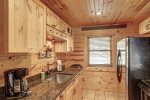Eagle`s Lair kitchen with tongue and  grove wood ceilings.