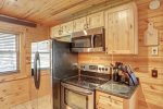 Eagle`s Lair kitchen with beautiful wood cabinets.