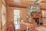 Eagle`s Lair dining area with wood burning fireplace.
