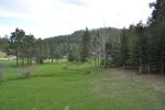 Chase`s cabin living room with beautiful wood ceiling and leather furniture..