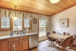 Chase`s cabin kitchen with hardwood cabinets.
