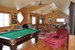 Clubhouse with game room and pool table and air hockey.