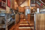 Gold Camp Lodge kitchen with stainless steel appliances.