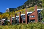 The Silverpick Townhomes were designed in the mining country vernacular and feature steep angled roofs and rusty metal siding.