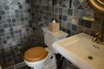 Natural Slate, Walk in Shower, Pedestal Sink and Plush Towels